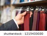 crop of man's hand holding... | Shutterstock . vector #1215433030
