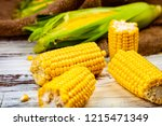 ripe corn on a wooden table... | Shutterstock . vector #1215471349