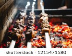 three shish kebabs are fried on ... | Shutterstock . vector #1215471580