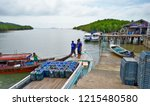 Small photo of Bang Rong, Thailand - October 15, 2014: The Bang Rong pier, located in an estuary surrounded by a mangrove forest, on the northeast side of Phuket island.