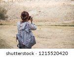 back view asian woman using... | Shutterstock . vector #1215520420
