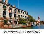 view of houses and canal street ... | Shutterstock . vector #1215548509
