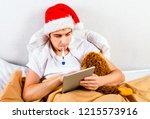 sick young man in santa hat... | Shutterstock . vector #1215573916