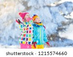 kids playing in snow. children... | Shutterstock . vector #1215574660