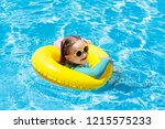 child with sunglasses in... | Shutterstock . vector #1215575233