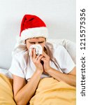 sick young man in santa hat... | Shutterstock . vector #1215575356