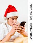 surprised young man in santa... | Shutterstock . vector #1215577339