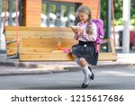 little girl with lunch on a... | Shutterstock . vector #1215617686