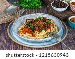 kushari   egyptian vegetarian... | Shutterstock . vector #1215630943