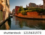 view of houses and canal street ... | Shutterstock . vector #1215631573