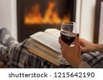 woman reading book and drinking ... | Shutterstock . vector #1215642190