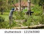 bali   january 25. man cleaning ... | Shutterstock . vector #121565080