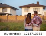 couple looking at their house | Shutterstock . vector #1215713383