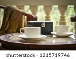 coffee cups on coffee table... | Shutterstock . vector #1215719746