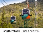 BANFF, AB, CANADA - JUNE 2018: Cable car gondolas travelling up and down Sulphur Mountain in Banff. - stock photo