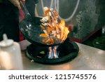 cook fries vegetables in a wok...   Shutterstock . vector #1215745576