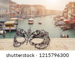 venetian masks on bridge agaist ... | Shutterstock . vector #1215796300