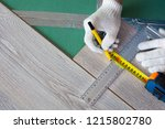 man measures the new laminate | Shutterstock . vector #1215802780