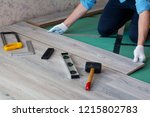 man installs new laminate... | Shutterstock . vector #1215802783
