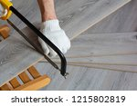 man sawing laminate | Shutterstock . vector #1215802819