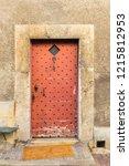 old red wooden door with iron...   Shutterstock . vector #1215812953