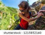 woman hiker climbs the rocky... | Shutterstock . vector #1215852160