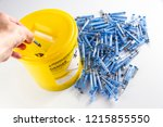 needles being put ito a sharps...   Shutterstock . vector #1215855550