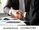 man in suit shake hand as hello ... | Shutterstock . vector #1215865789