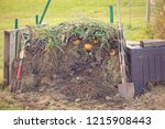 fresh compost pile  with green... | Shutterstock . vector #1215908443