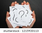 hands with a note written by a... | Shutterstock . vector #1215920113