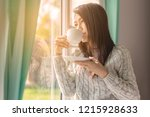 asian woman in bedroom drinking ...   Shutterstock . vector #1215928633