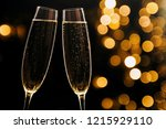 two glasses of champagne on... | Shutterstock . vector #1215929110