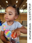 biracial toddler at the arena... | Shutterstock . vector #1215972919
