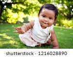 cute baby girl with a smile on... | Shutterstock . vector #1216028890