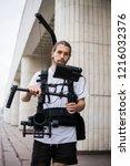 professional videographer... | Shutterstock . vector #1216032376