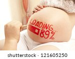 Pregnant Woman With Painted...