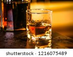pouring whiskey drink into... | Shutterstock . vector #1216075489