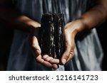 woman's hands holding dark ... | Shutterstock . vector #1216141723