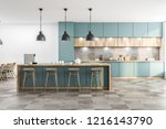 Stock photo green kitchen with bar 1216143790