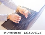 woman hands locked to laptop by ... | Shutterstock . vector #1216204126