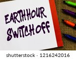 handwriting text earth hour... | Shutterstock . vector #1216242016