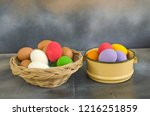 basket and bowl of colored eggs ... | Shutterstock . vector #1216251859