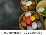 basket and bowls of colored... | Shutterstock . vector #1216254013