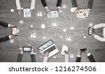 group of people with devices in ... | Shutterstock . vector #1216274506