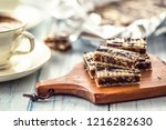 a waffle cake with caramel... | Shutterstock . vector #1216282630