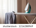 ironed shirt hanging from an...   Shutterstock . vector #1216288969