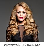 blond woman with long curly... | Shutterstock . vector #1216316686