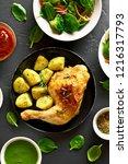 baked chicken leg with potato.... | Shutterstock . vector #1216317793