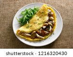 omelette stuffed with mushrooms ... | Shutterstock . vector #1216320430