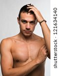 handsome bare chested young man | Shutterstock . vector #121634140